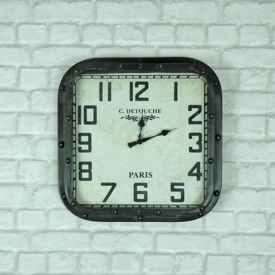 Industrial studded wall clock