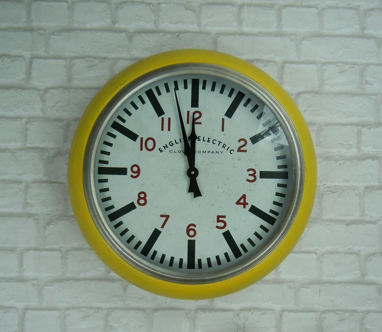 Metal yellow wall clock