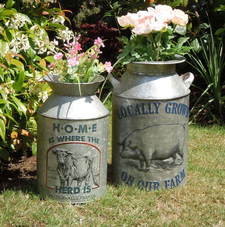 Vintage design galvanised metal churns