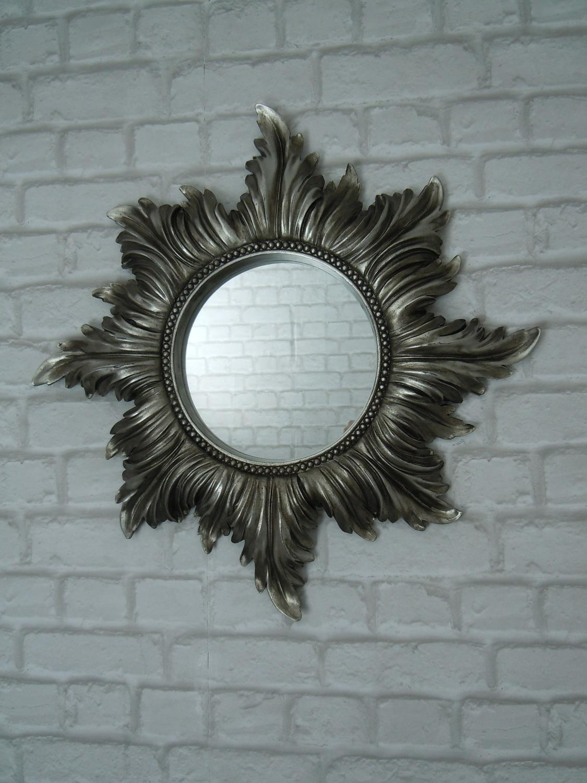 Antique silver star mirror