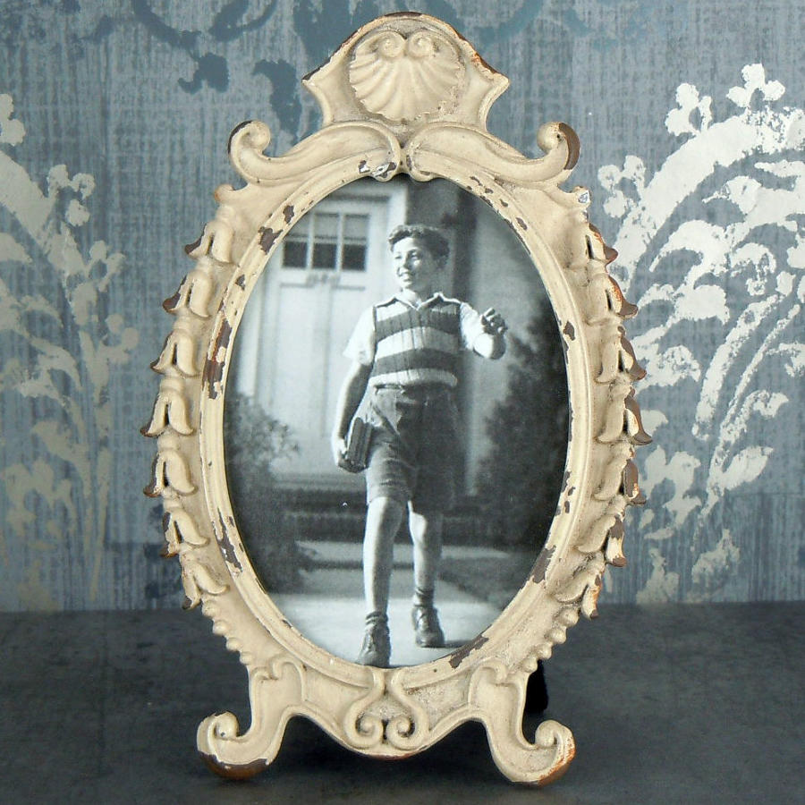 Aged oval metal photo frame