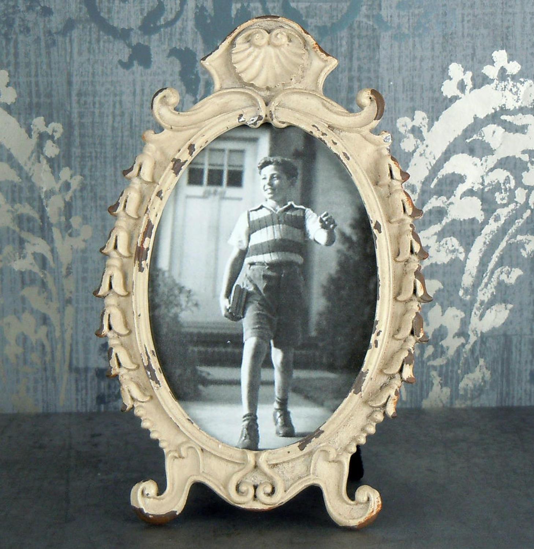 Aged oval metal photo frame