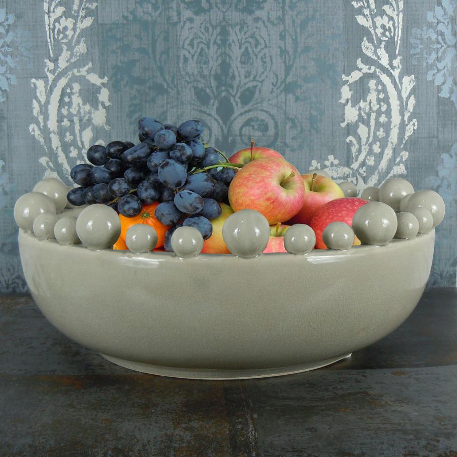 Cream ceramic bowl with balls on the rim