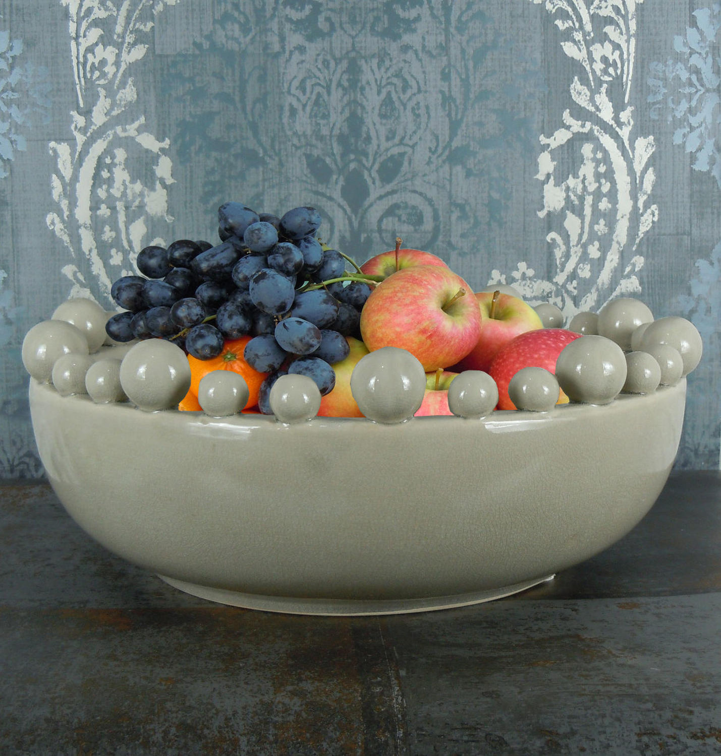 Cream ceramic bowl with balls on the rim
