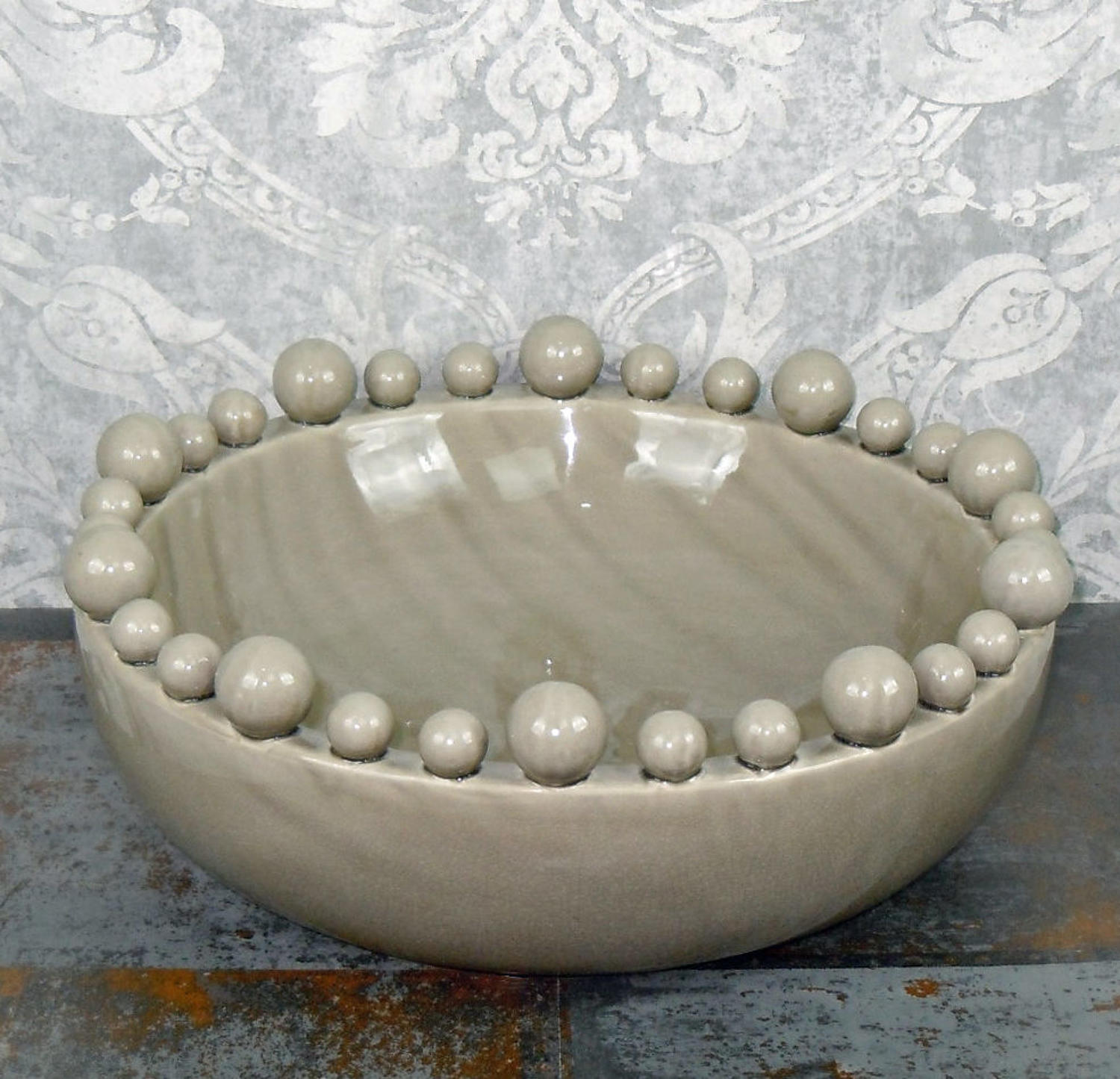 Grey ceramic bowl with balls on the rim