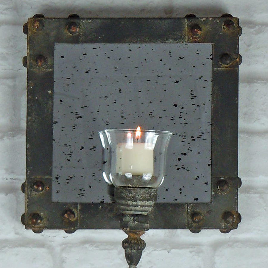 Distressed metal mirror with candle holder