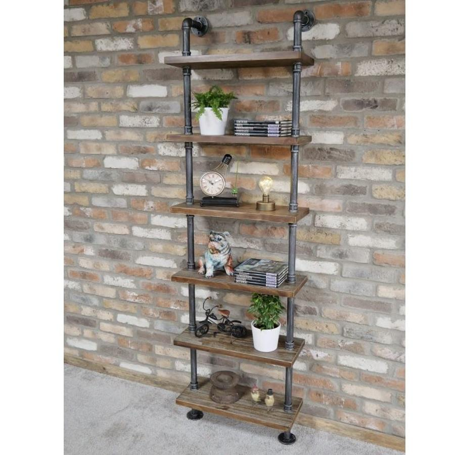 Industrial wood shelving unit with steel pipes.