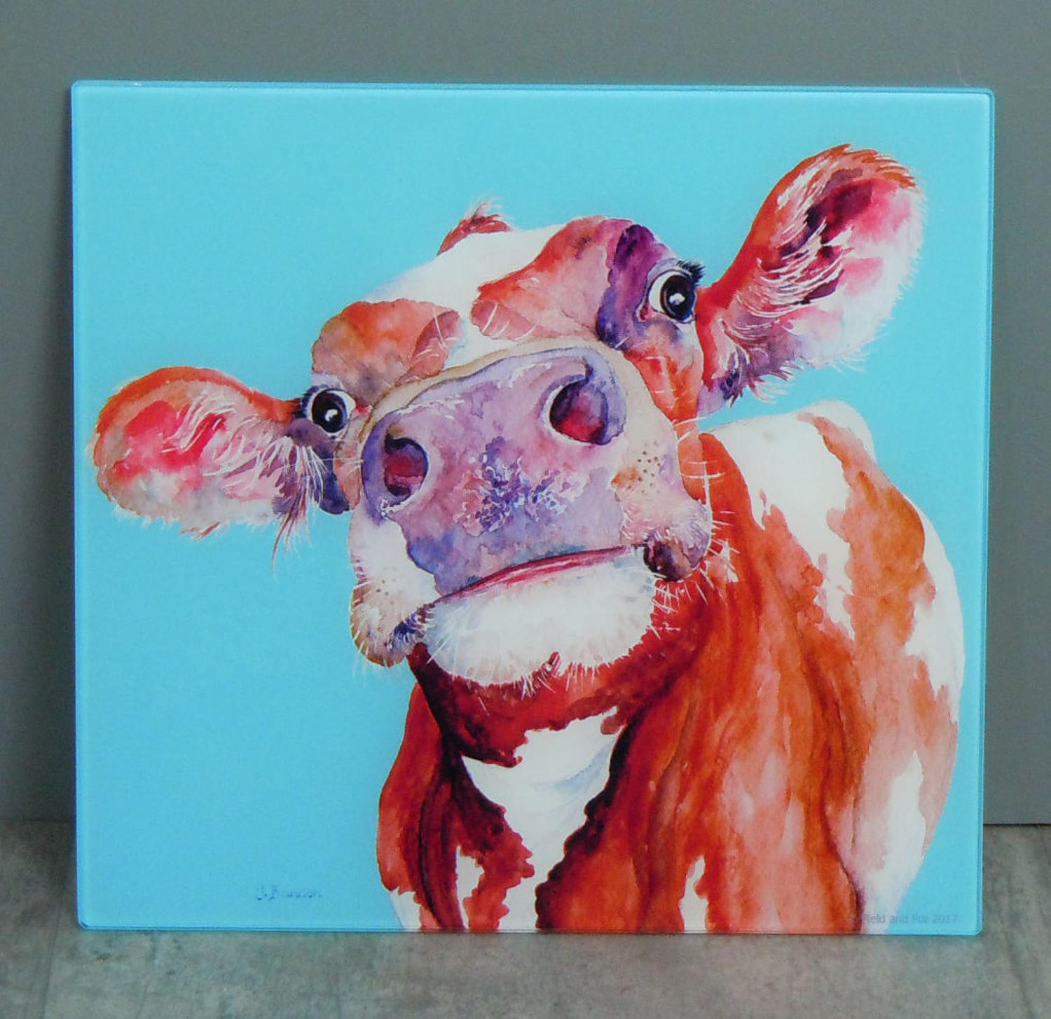 Glass Cow chopping board, worktop saver
