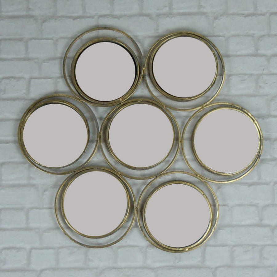 Seven circle rustic gold metal mirror