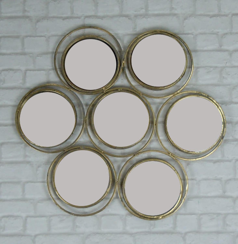 Seven circle rustic gold metal mirror