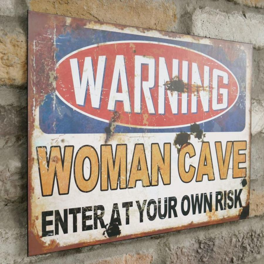 Metal wall hanging Woman Cave sign