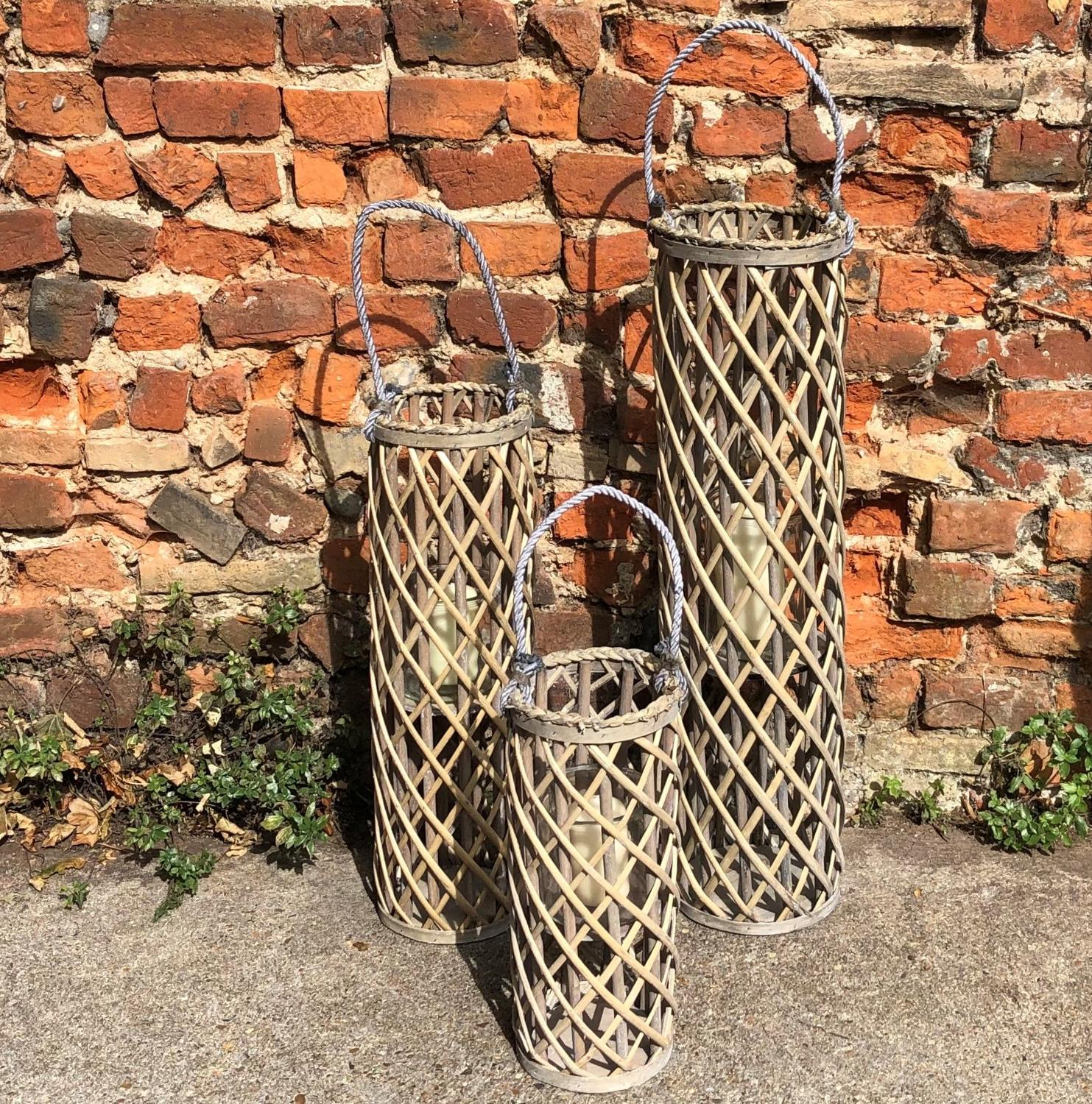 Wicker lantern with glass hurricane