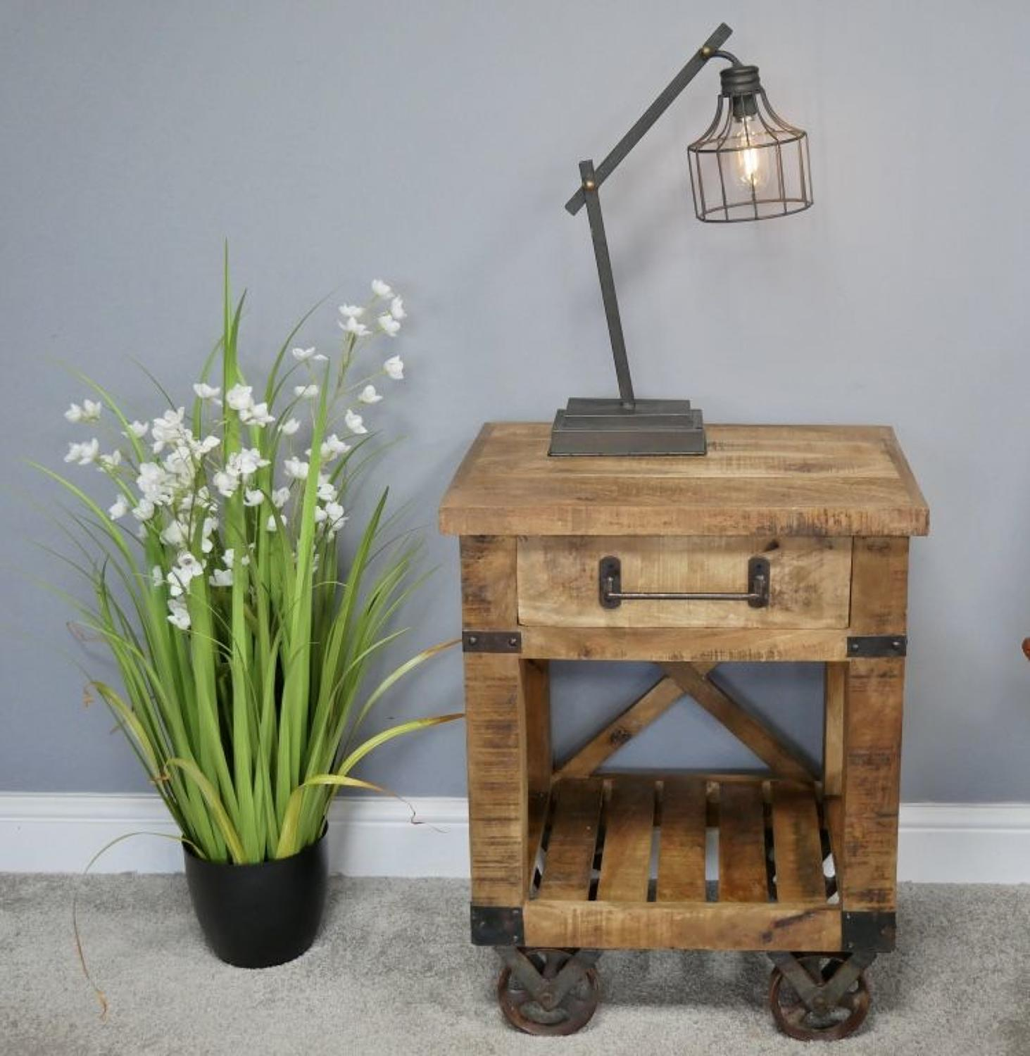Industrial style side table with iron wheels