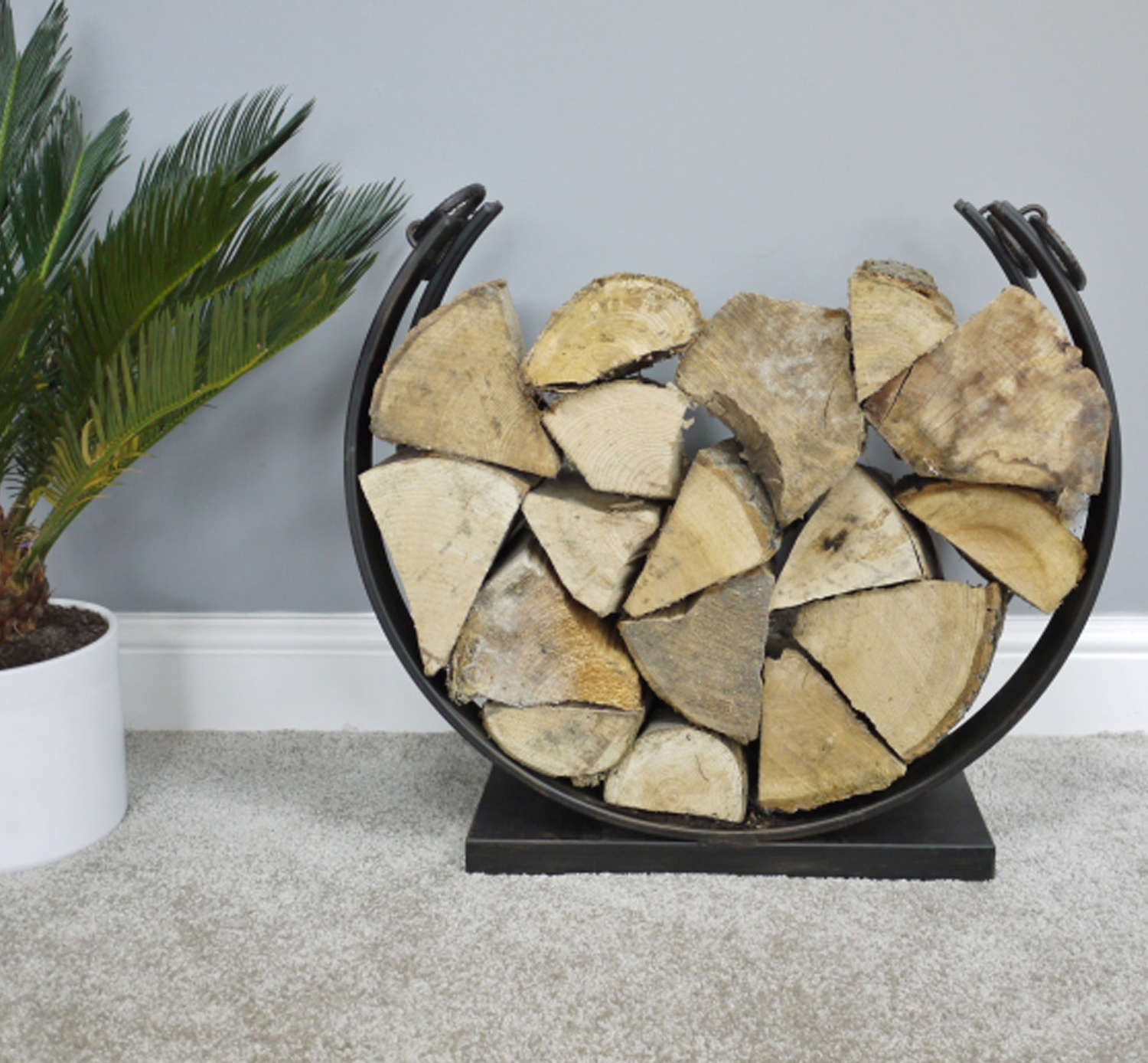 Log holder made from metal