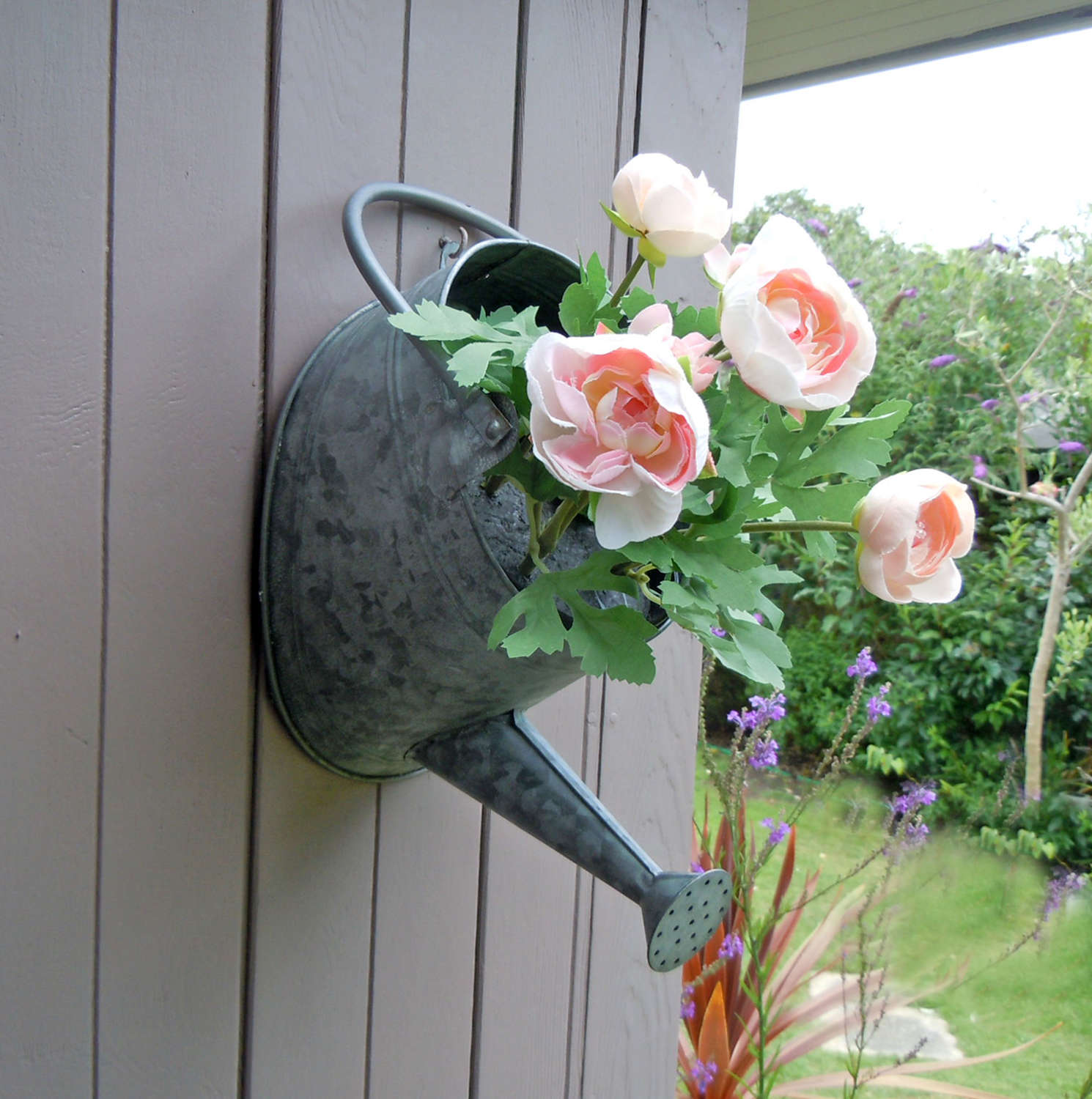 Metal watering can wall planter