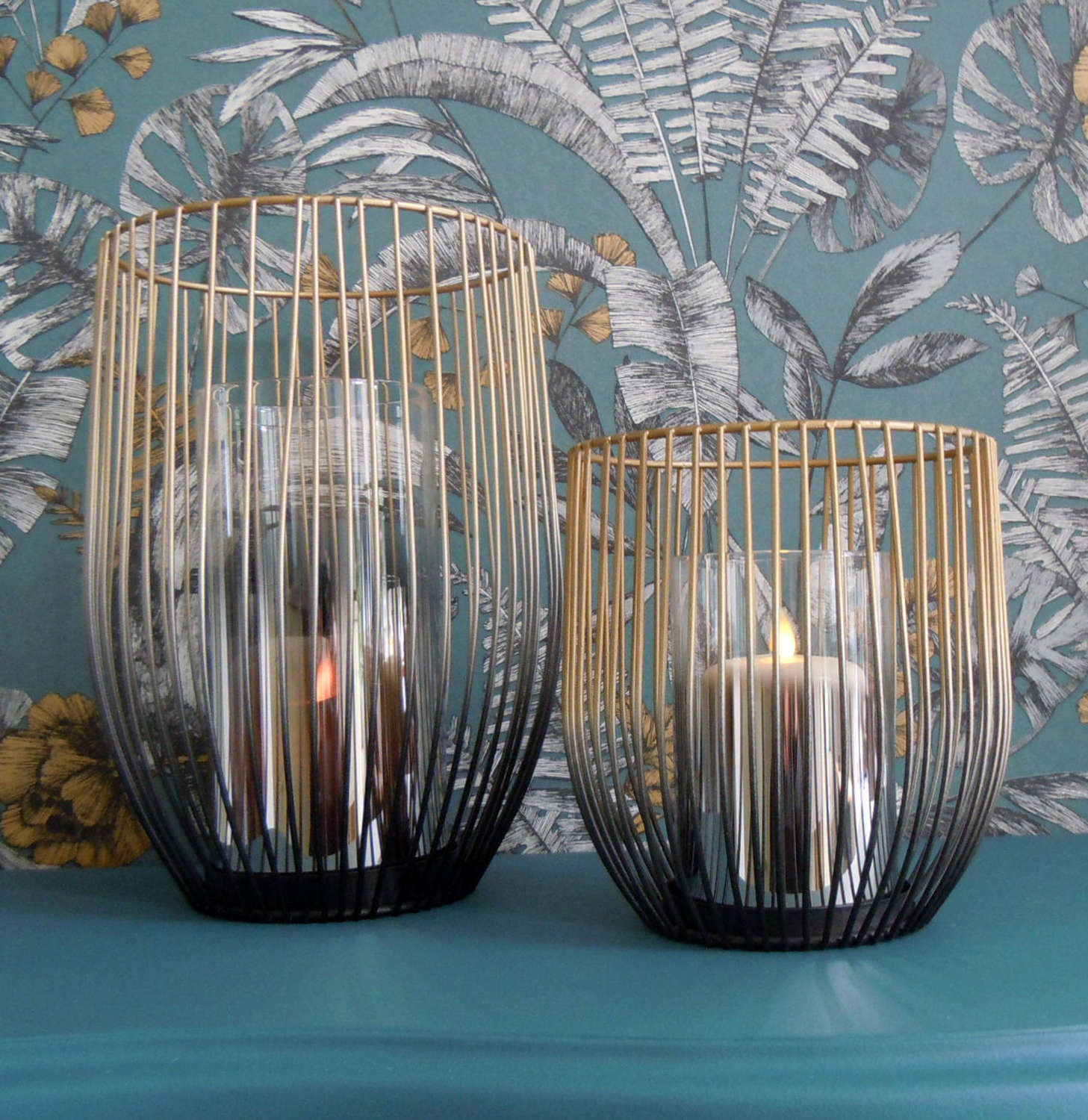 Gold and black curved metal candle holders