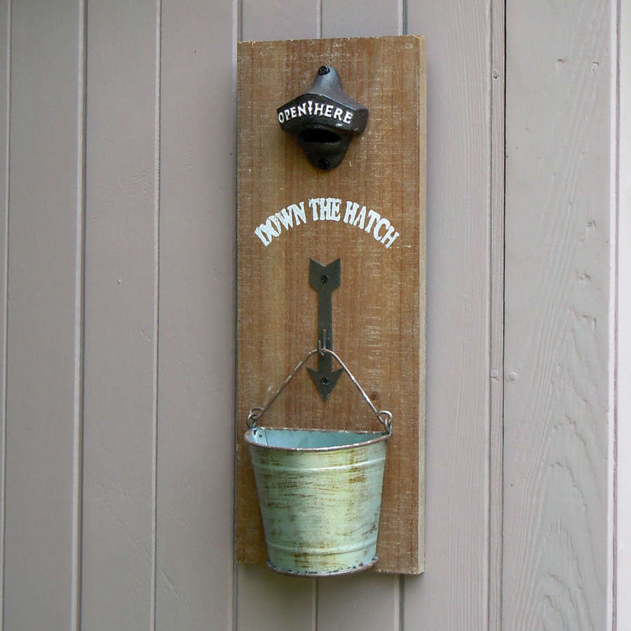 Wall hanging metal bottle opener