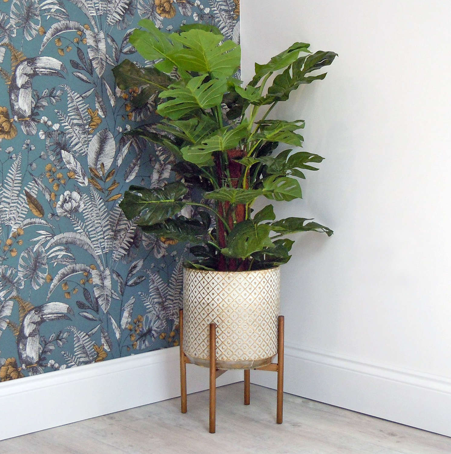 Layla Gold and White metal planter on a stand
