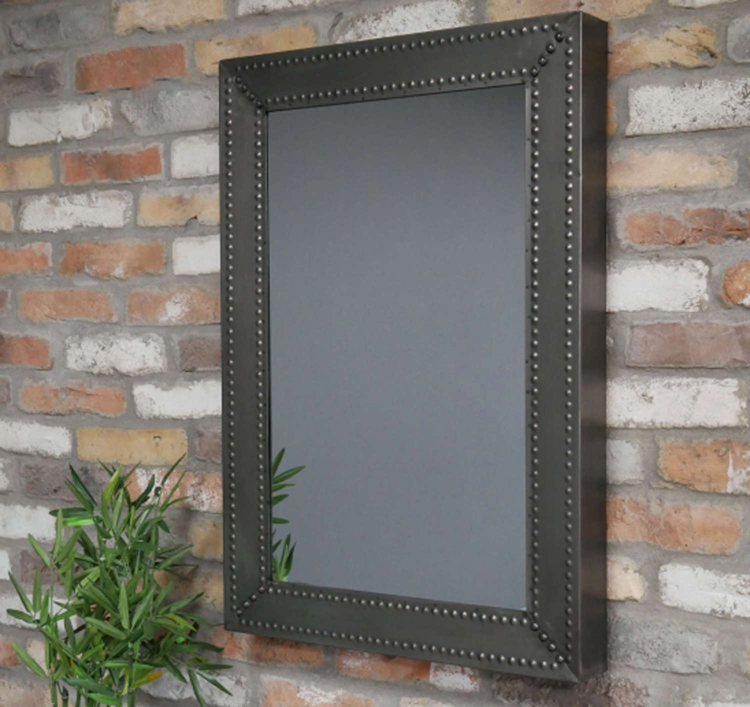 Industrial style metal studded mirror