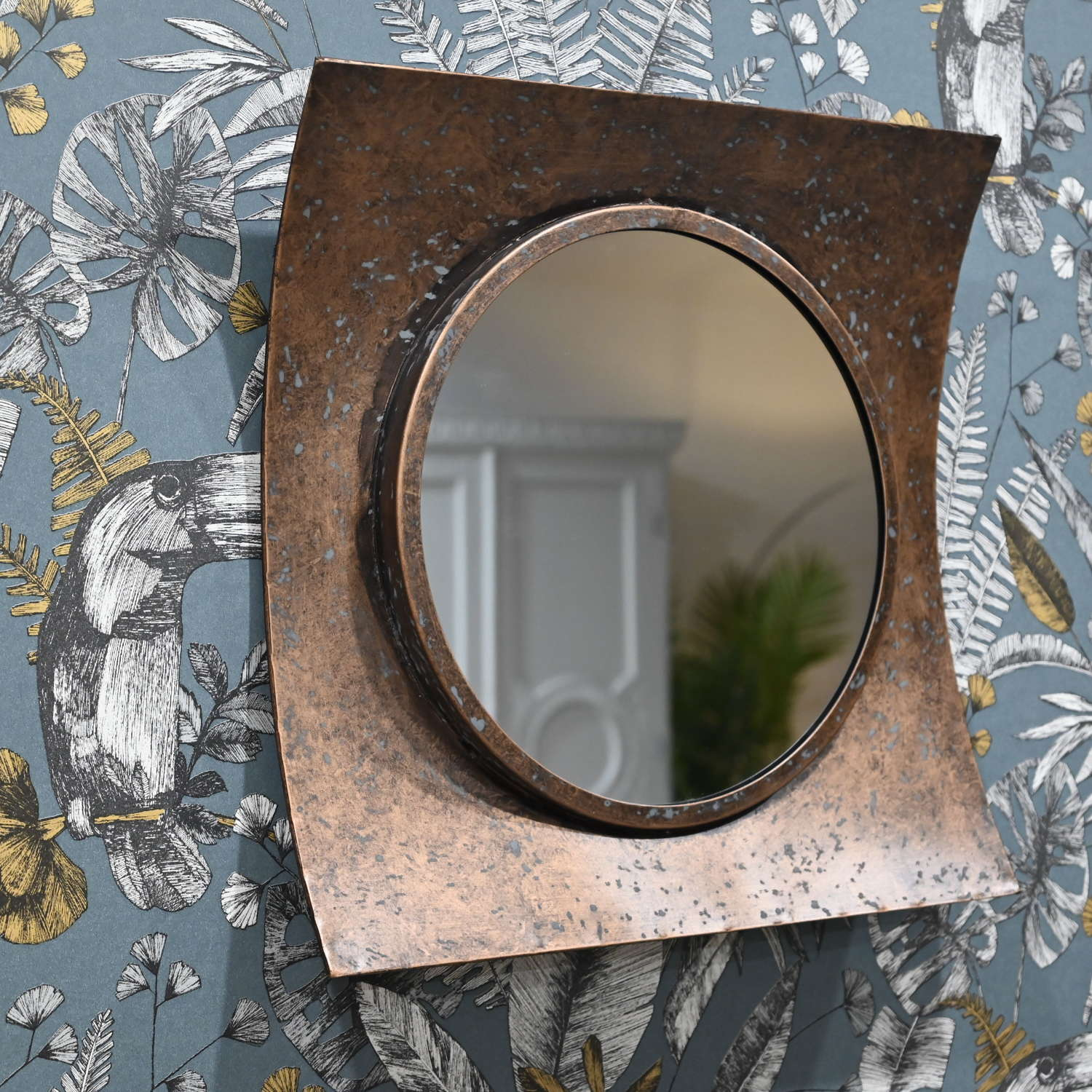 Rustic curved bronzed mirror