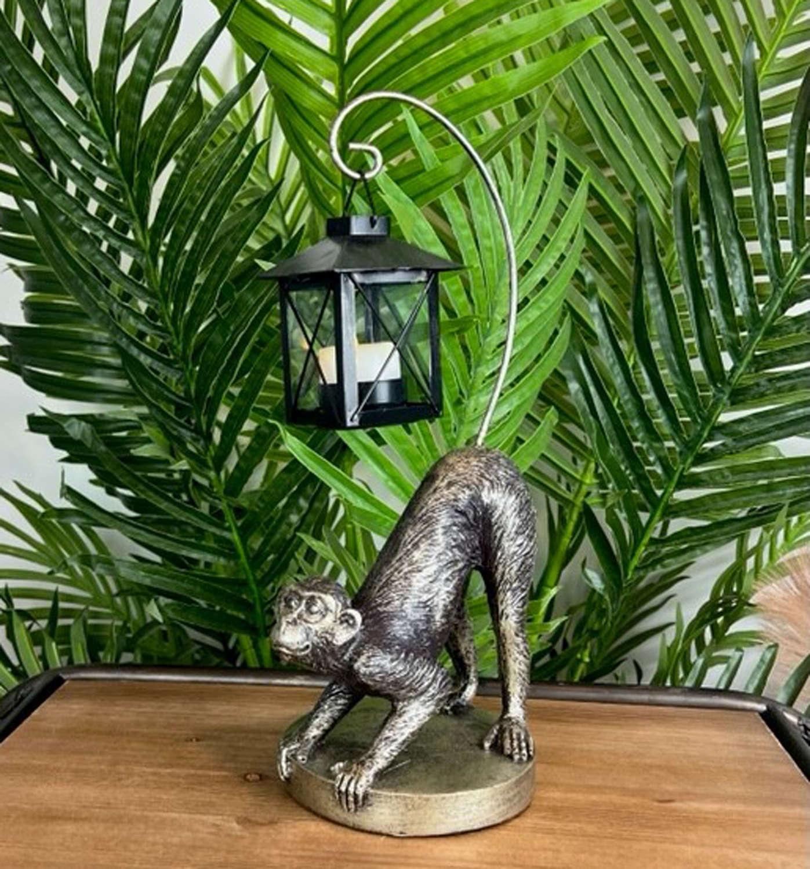 Bronzed effect Monkey holding a lantern