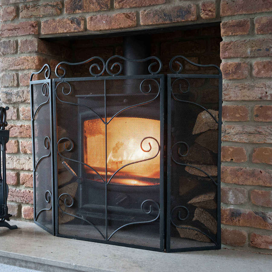 Black Victorian style fire screen