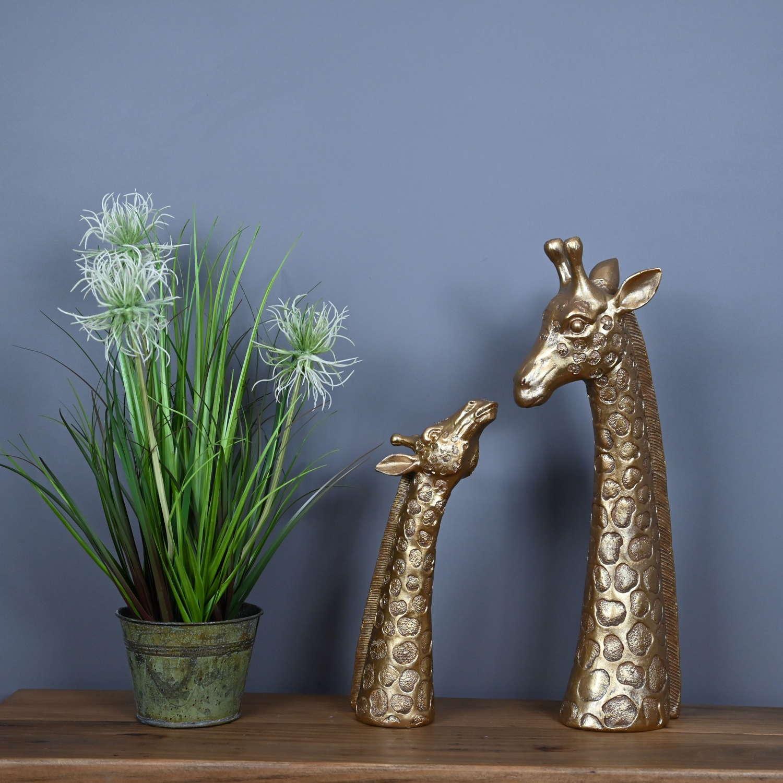 Gold Mum and baby Giraffe sculptures