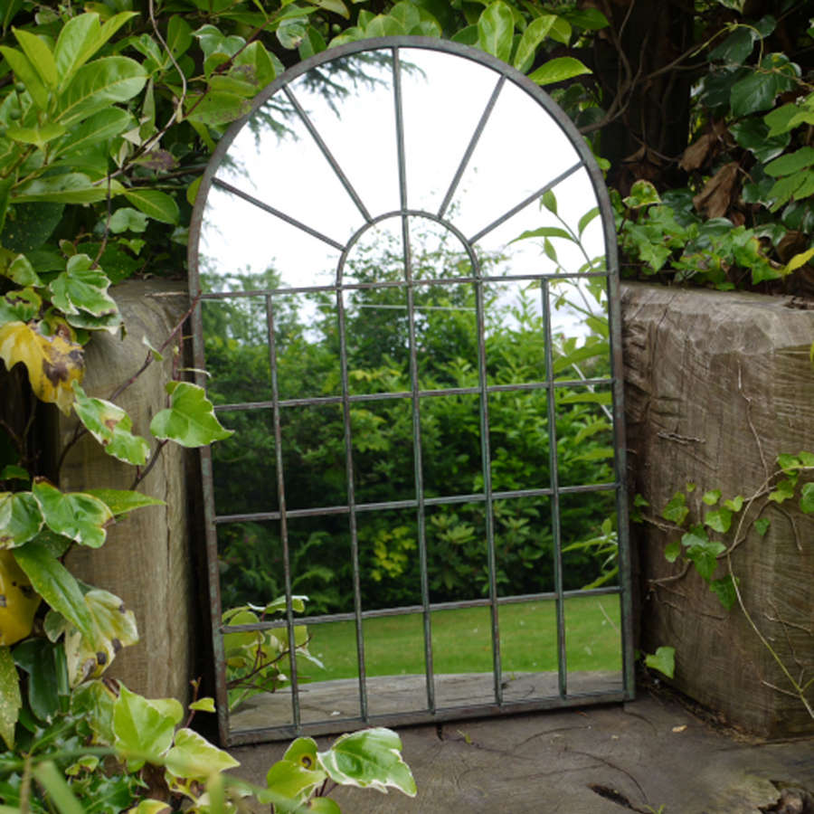 Metal framed arched window style mirror