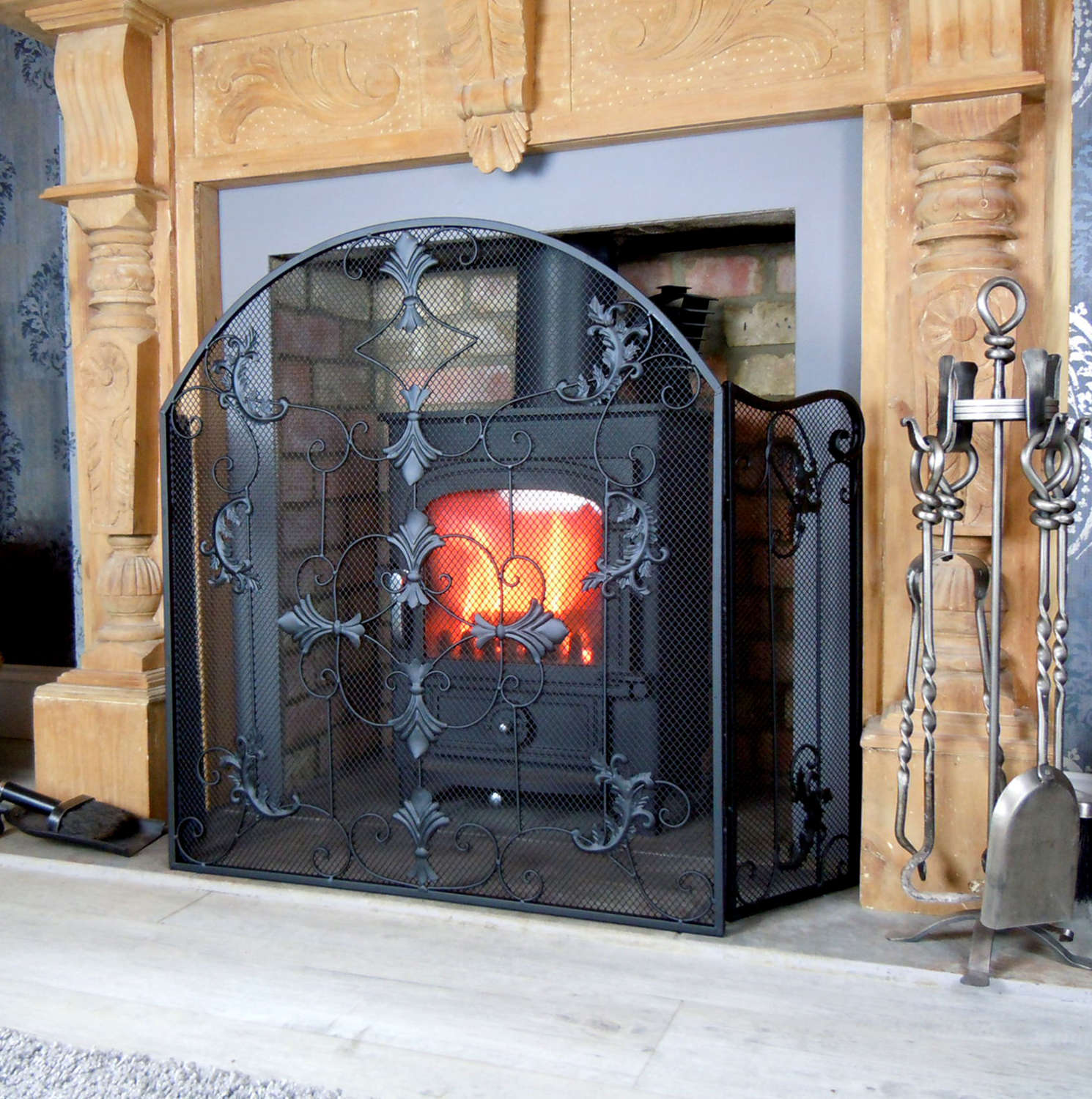 Black ornate style fire screen