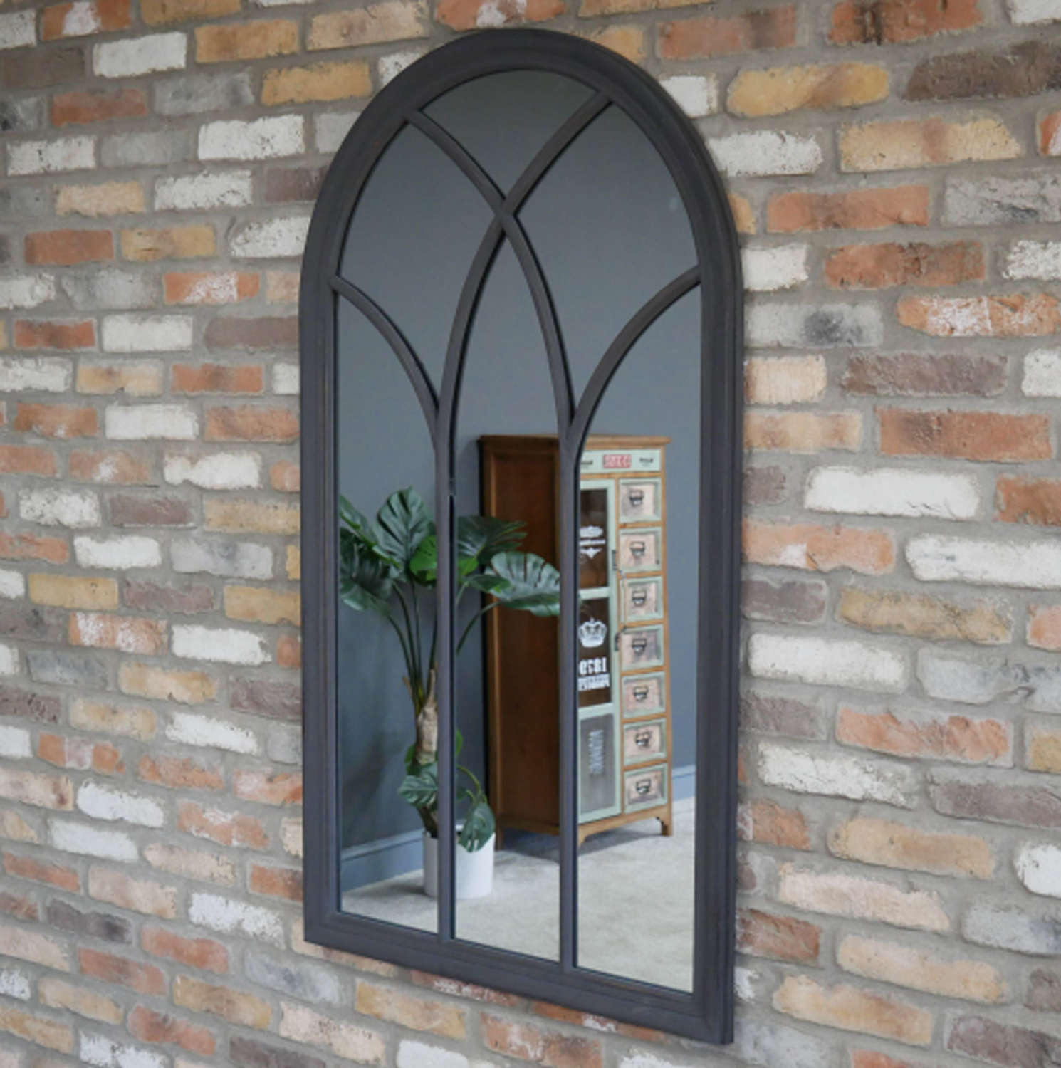 Dark Grey distressed wooden framed arch mirror.