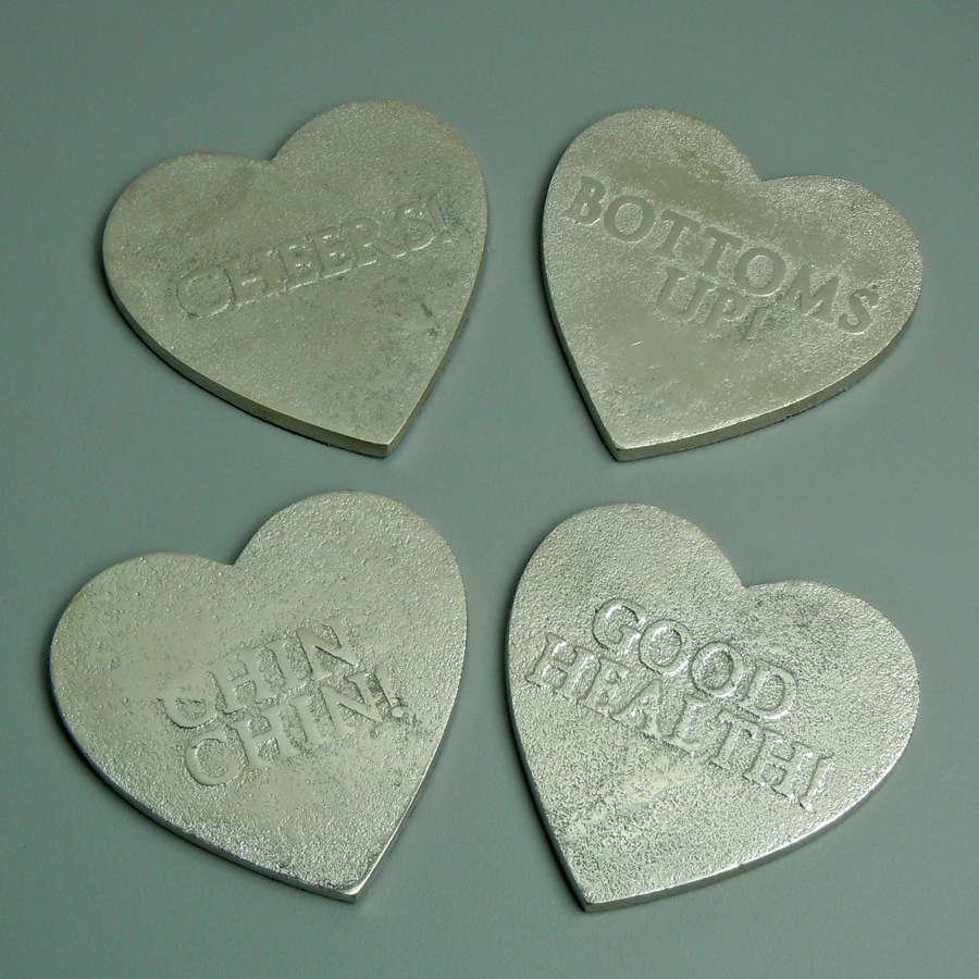 Silver heart aluminium coasters