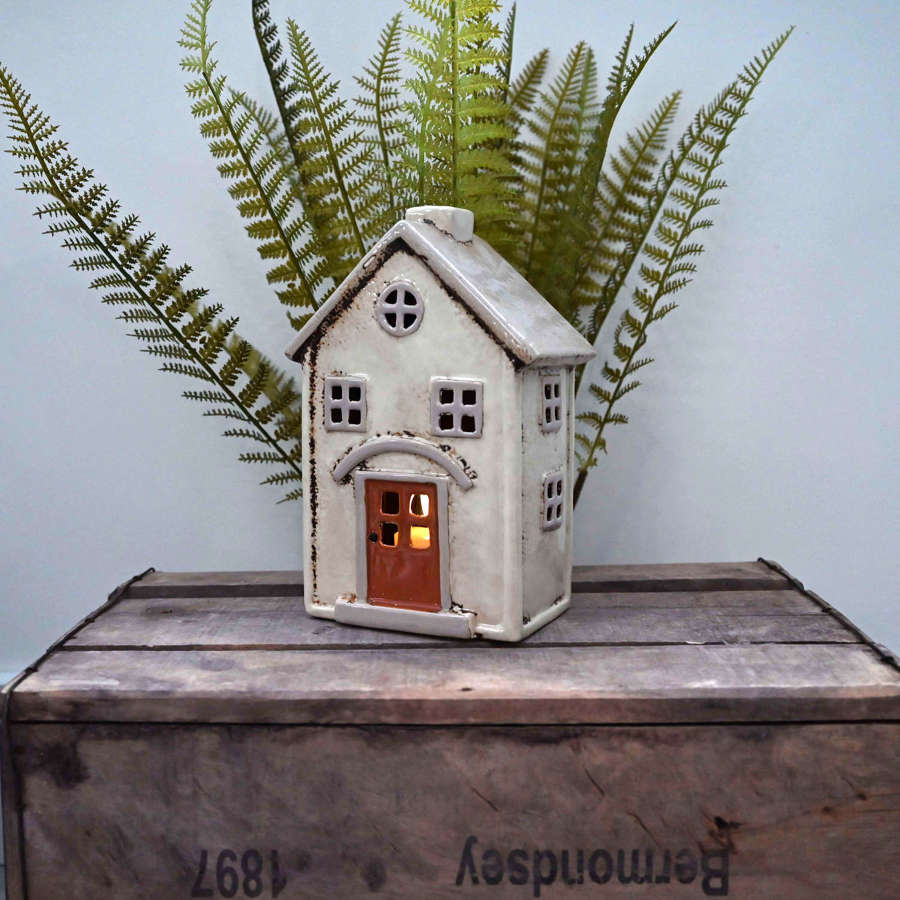 Pottery Village cream and beige house tealight holder