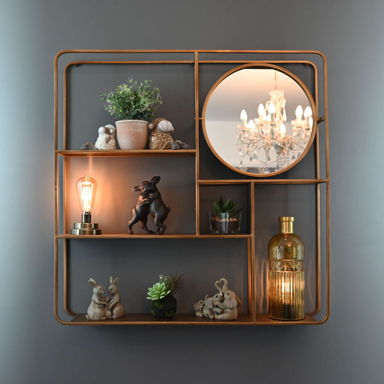 Gold metal wall shelving unit with round mirror