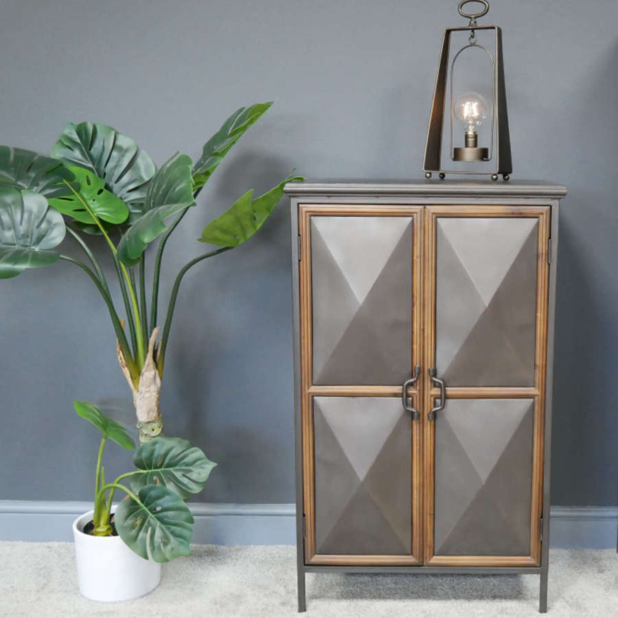 Industrial distressed metal cabinet with diamond convex doors