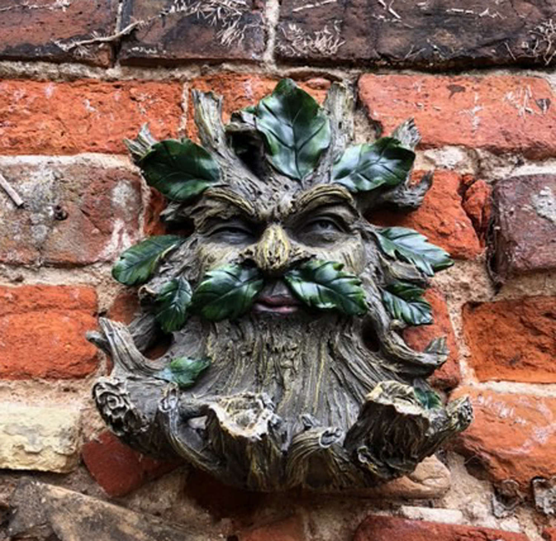Green Man wall hanging bird feeder