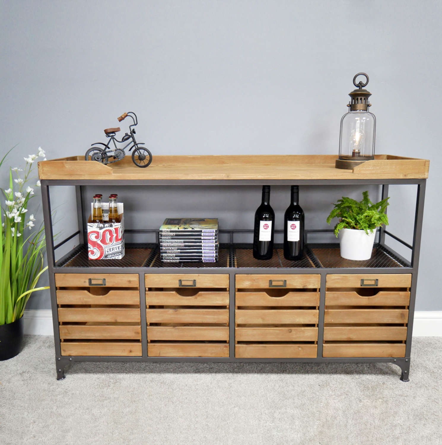 Industrial style sideboard cabinet with four drawers.