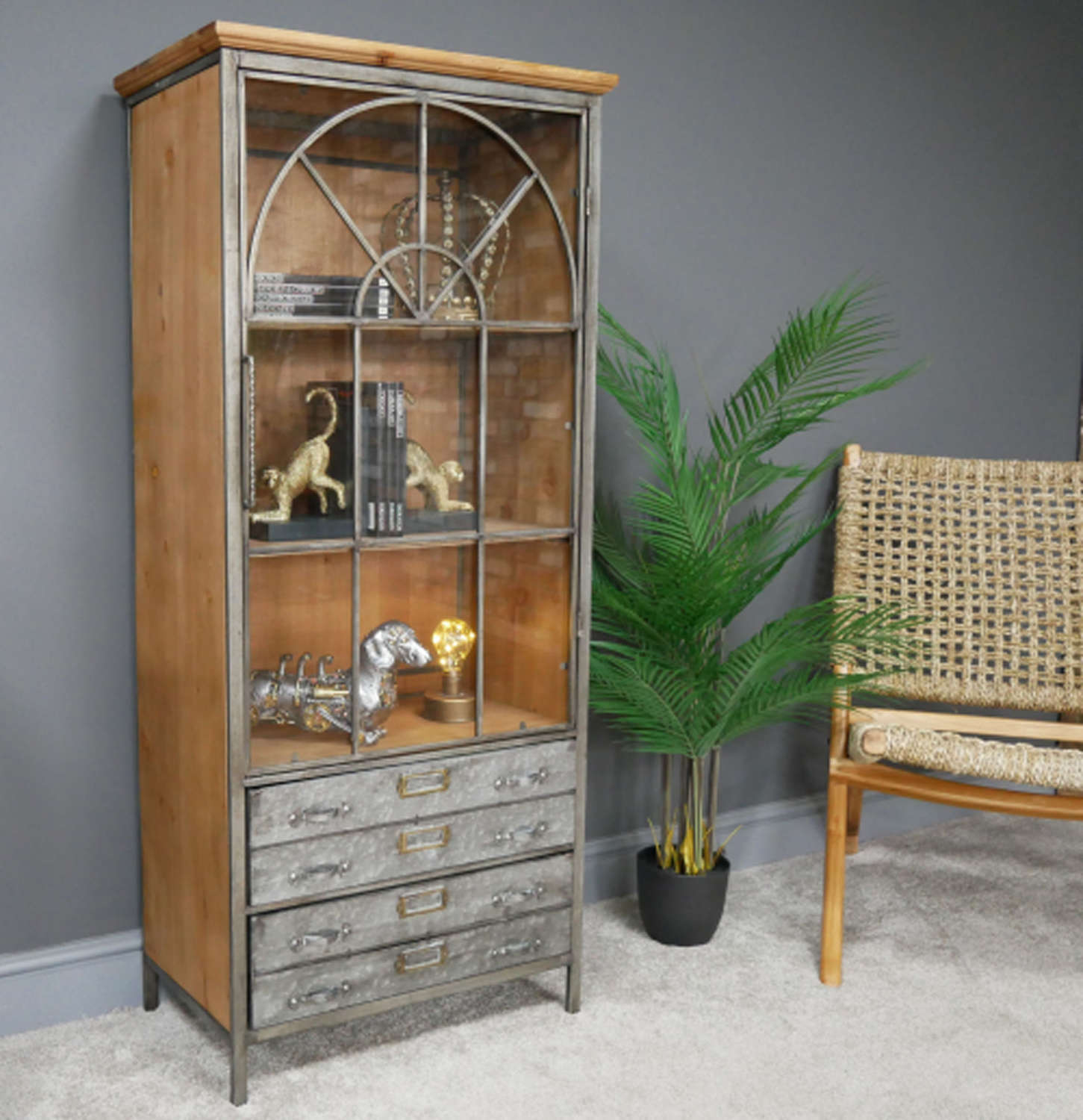 Metal and wood display cabinet with drawers