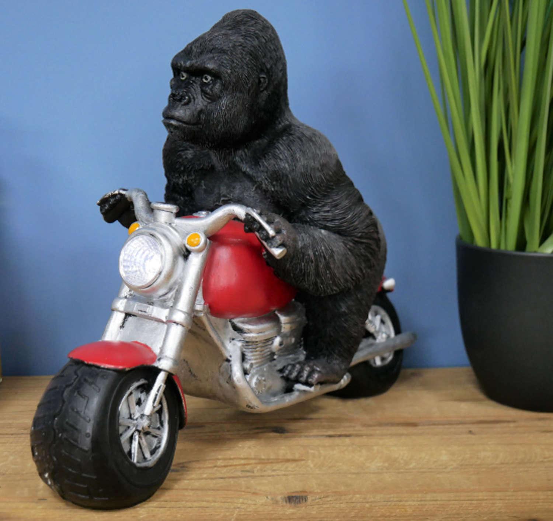 Gorilla on motorbike with solar powered light